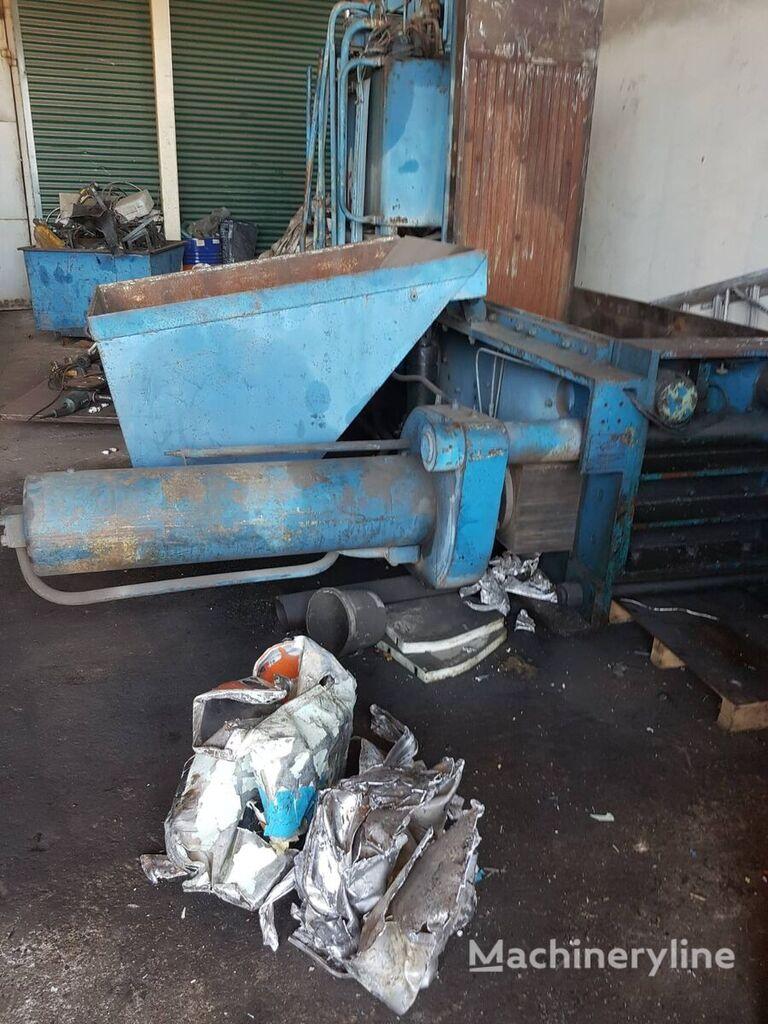 Metalo presas contenedor compactador